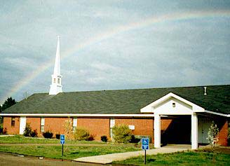 Victory Baptist Church with rainbow overhead